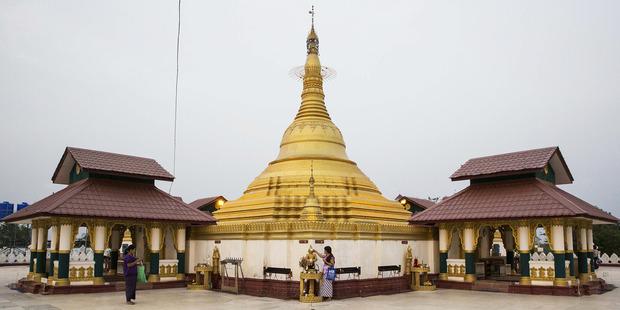 A worshiper prays at a small pagoda in Naypyidaw, Myanmar. Photo / Bloomberg
