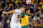 NZ's Ryan Nelsen tangles with Australia's Tim Cahill in 2010. Photo/Photosport
