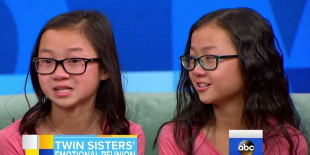 Twin sisters Gracie Rainsberry (right) and Audrey Doering (left) met for the first time in person after being adopted by two different US families as babies. Photo / ABC