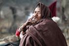 A homeless Indian woman smokes in Jammu, India. Photo / AP
