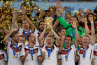 Germany's Bastian Schweinsteiger holds up the World Cup trophy. Photo / AP