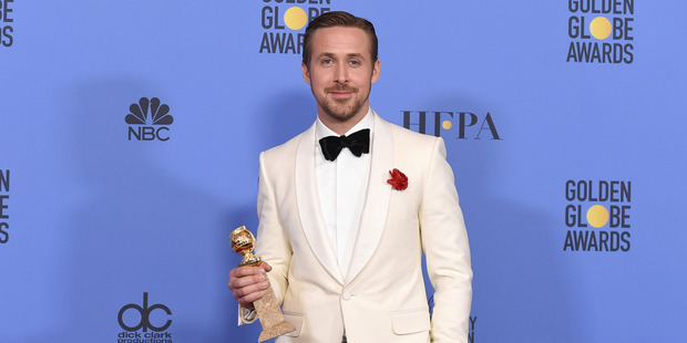 Ryan Gosling poses in the press room with the award for best performance by an actor in a motion picture - musical or comedy for 'La La Land'. Photo / AP