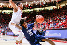 Nevada's Lindsey Drew slips driving around New Mexico's Elijah Brown during the second half of the thrilling game. Photo / AP