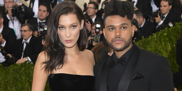 Bella Hadid, left, and The Weeknd have been talking again after their split. Photo / AP