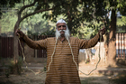 Ramesh Chand Kushawh, 78, holds his moustache in his hands. Photo / Australscope
