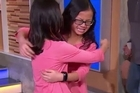 "A pair of twins who were separated at birth in China, and then adopted by two different American families who lived hundreds of miles apart, were reunited for the first time in person today live on ""Good Morning America.""  Credit: ABC"