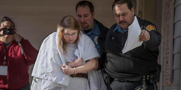 Sara Packer, handcuffed, the adoptive mother of Grace Packer, is led out of District Court in Newtown, Pennsylvania. Photo / AP
