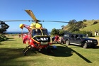A woman was flown to hospital after she hurt her spine on a boat in Fletchers Bay. Picture / Auckland Westpac Rescue Helicopters