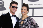 Robin Thicke and ex wife Paula Patton, seen here in 2014, are having a legal dispute over allegations he spanked their son. Photo/Getty