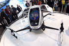 Attendees look at an EHang 184 autonomous-flight drone that can fly a person. Photo / Getty Images