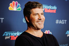 Simon Cowell has sold a stake in his entertainment empire for a staggering $150 million. Photo / Getty Images