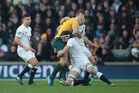 Australia's Stephen Moore gets tackled by England's Tom Wood. Photo / Getty Images