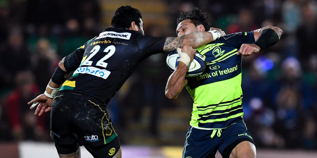 Loading George Pisi of Northampton Saints puts in a high tackle on Isa Nacewa of Leinster. Photo/Getty Images