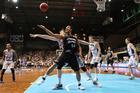 Mika Vukona battles for possession under the hoop against Adelaide. Photo / Getty