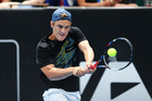 Finn Tearney plays a backhand in his match against Robin Haase at the ASB Classic. Photo / Getty Images