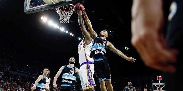Shea Ili of the Breakers blocks the shot from Josh Powell of the Kings. Photo / Getty