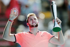 Jack Sock celebrates with his trophy after winning the ASB Classic. Photo / Getty Images
