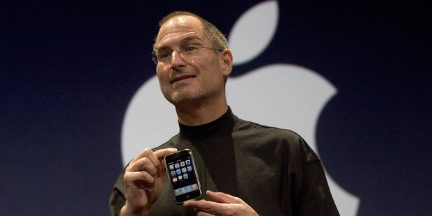 Former Apple CEO Steve Jobs holds up the first iPhone that was introduced on January 9, 2007 in San Francisco, California. Photo / Getty