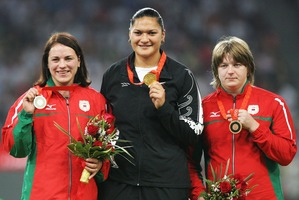 Nadzeya Ostapchuk, right, stands on the podium next to Valerie Adams during the 2008 Olympics shot put medal ceremony. Photo / Getty