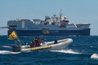 Greenpeace crews in inflatable boats are targeting the 125m Amazon Warrior, which is prospecting for oil off Wairarapa. Photo / supplied