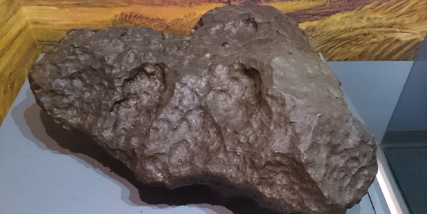 An exhibit of an asteroid rock which is believed to have had impact on the dinosaur extinction. Photo / Nkansahrexford