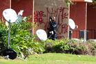 Orlando Police SWAT team surround apartments off Cinderlane Parkway in Orlando, Florida. Photo / AP