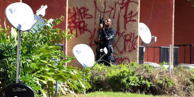Loading Orlando Police SWAT team surround apartments off Cinderlane Parkway in Orlando, Florida. Photo / AP