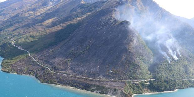 Firefighters say it will take up to five days to put out the fire that has ravaged 150 ha south of Queenstown. Photo / Facebook
