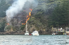 A large fire burns at Vivian Bay, Kawau Island. Photo / Supplied via Lorenzo Canal