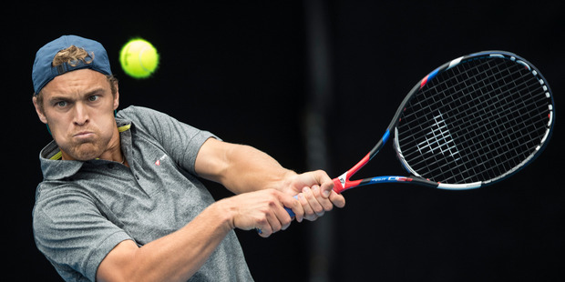 Finn Tearney of NZ in action against Cameron Norrie of UK in the final round of qualifying for the ASB Classic tennis tournament held at the ASB Tennis Arena. Photo / Jason Oxenham.
