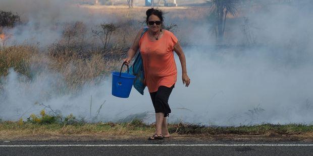 Residents help battle a fire at Mahanga on Mahia Peninsula.  Photo / David Trubridge