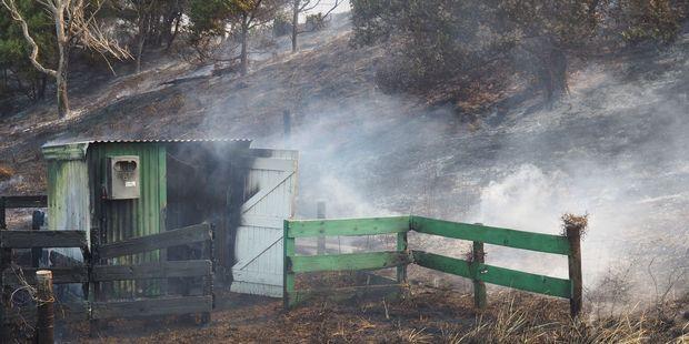 Hotspots continue to provide hard work for fire officers at Mahanga on Mahia Peninsula. PHOTO / DAVID TRUBRIDGE