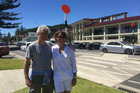 VISITORS: Eric Hoyeau and wife Anne Konitz in front of Sir Tristram House, the beach bach of Sir Patrick Hogan who they were hosted by on their visit to New Zealand. PHOTO/SUPPLIED