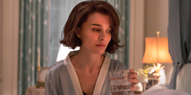Natalie Portman nails Jackie Kennedy's unusual private school accent and poised wide smile in the film, Jackie.