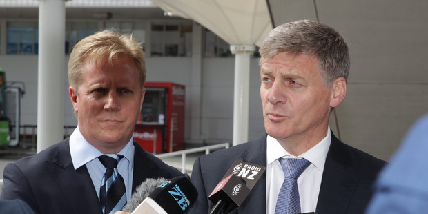 Prime Minister Bill English speaks to the media at Auckland Airport before flying to Europe. He is joined by Trade Minister Todd McClay. New Zealand Herald by Nick Reed.