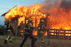 TOTAL LOSS: A young family of four are lucky to have escaped a house fire in strong winds. PHOTO/DAVID ELIOTT