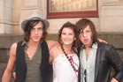Herald reporter Tess Nichol as a teenager meeting Kings of Leon's Jared Followill (left) and Matthew Followill (right) in Auckland, 2006. Photo / supplied