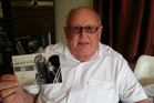 Trevor Dickason with a photo of when he regularly flew on a DC3 as a boy.