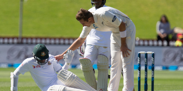 Loading New Zealand bowler Tim Southee checks the condition of Bangladesh batsman Shakib Al Hasan, who was hit by an attempted throw at the wickets. Photo / Mark Mitchell.