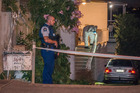Police and forensics attend a scene along St Johns Road, Auckland. Photo / Steven McNicholl