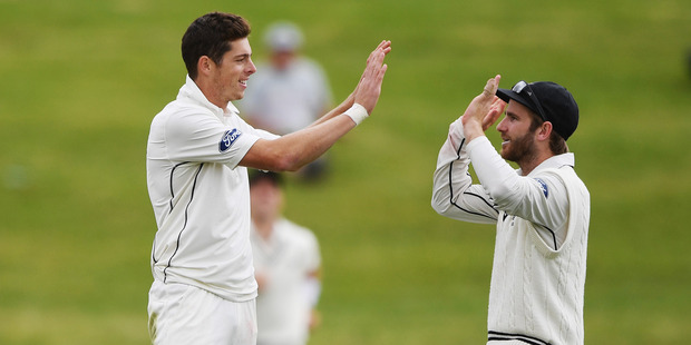 Mitchell Santner and Kane Williamson share a high five. Photo / Photosport