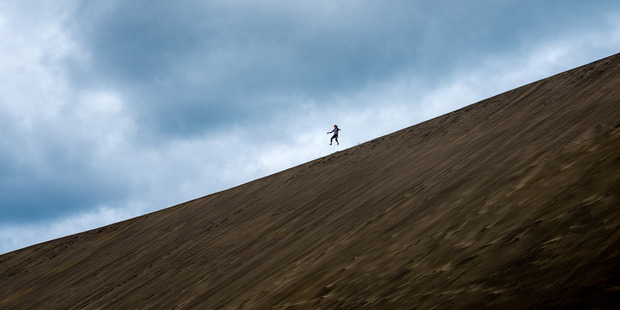 SECOND PLACE: Timothy Carlielle catching air at the sand dunes at Bethells. PHOTO/STEVE HARPER