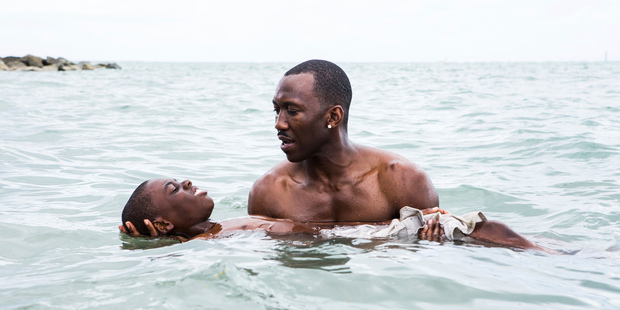 Alex Hibbert, foreground, and Mahershala Ali in a scene from the film Moonlight. Photo/AP