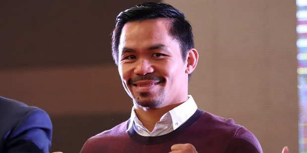 Filipino boxer Manny Pacquiao poses for fans during a meeting with fans in Seoul, South Korea. Photo / AP