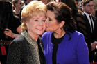 A moving montage tributed to Carrie Fisher kisses her mother, Debbie Reynolds was played at the Golden Globes. Photo / AP