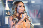 Mariah Carey is taking a step back out of the limelight following a disastrous couple of weeks. Photo / AP