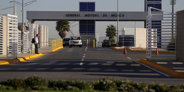 Cars exit the General Motors assembly plant in Villa de Reyes, outside San Luis Potosi, Mexico. Photo / AP