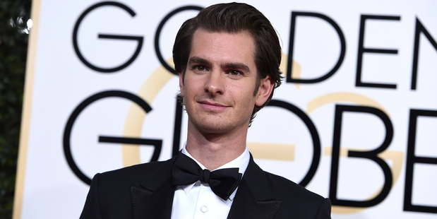 Loading Is this the face of a stoned man? Andrew Garfield arrives at the 2017 Golden Globes. Photo/AP
