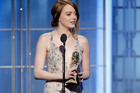 Emma Stone accepting her Golden Globe for La La Land. Photo/AP