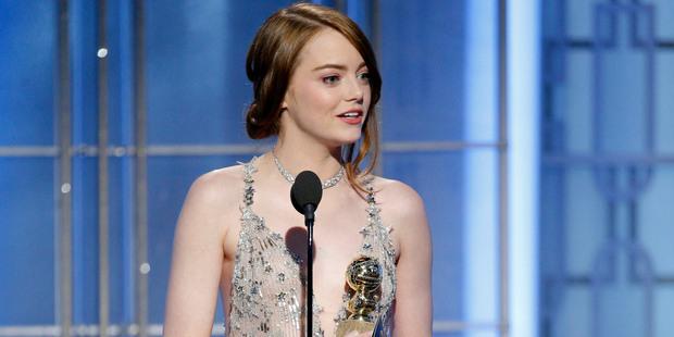 Emma Stone accepting her Golden Globe for La La Land. Photo/AP